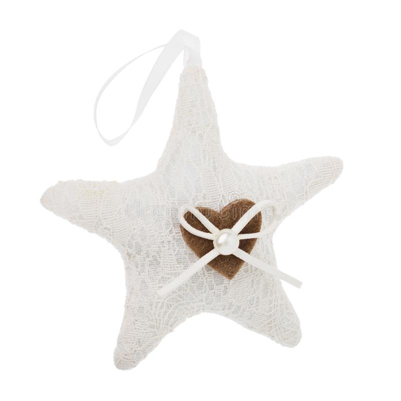 Soft toy of textile in the shape of a star. Christmas decoration in bright colors isolated royalty free stock images