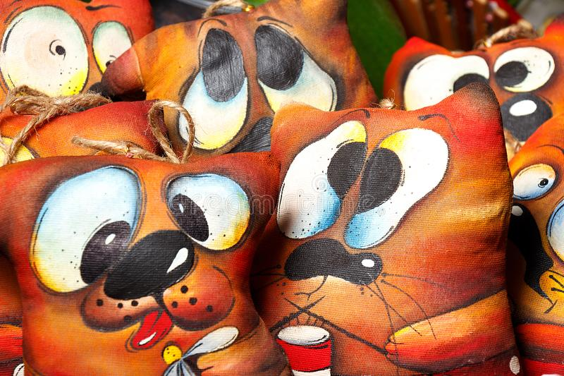 Soft toys in the form of a dog like valentines with various cheerful faces royalty free stock images