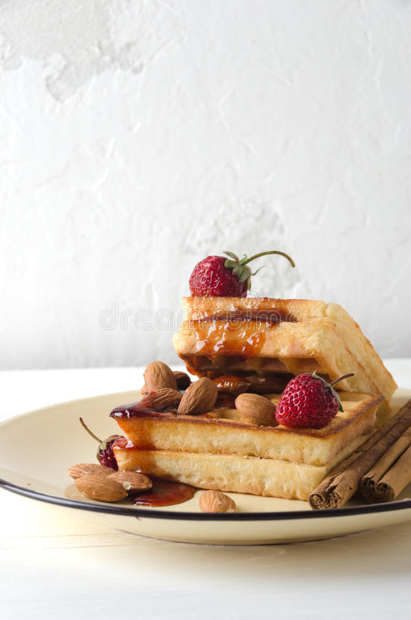 Soft waffles jam almonds strawberries Kettle royalty free stock photos