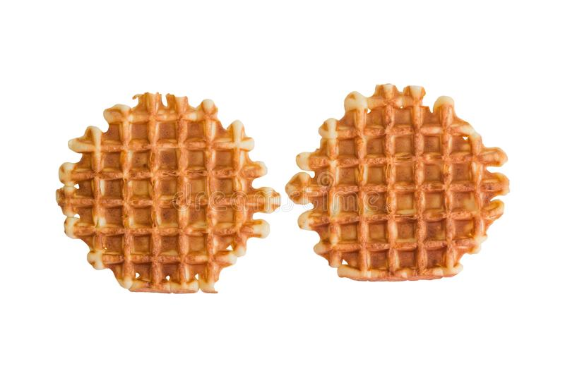 Soft waffles, sweet pastries, isolated on white background, close - up, royalty free stock photography