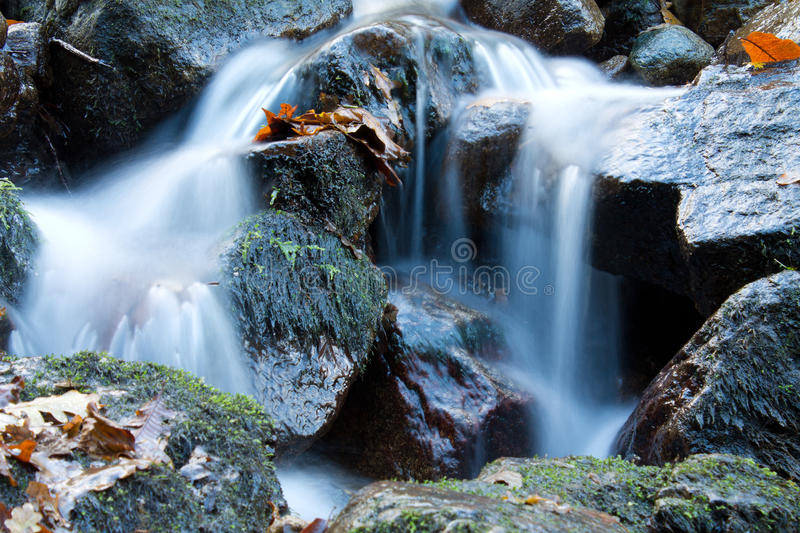 Soft waterfall river with rocks in forest in long exposure royalty free stock photography