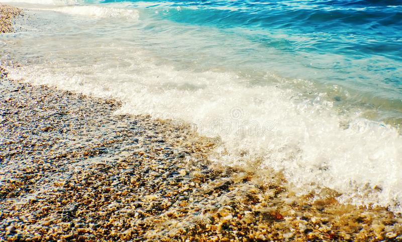 Soft wave of blue ocean on sandy beach Background. Summer stock images