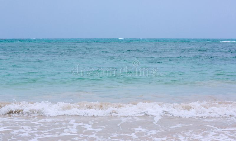 Soft wave of blue ocean on sandy beach. background. selective focus. beach and tropical sea white foam on beach. stock photography