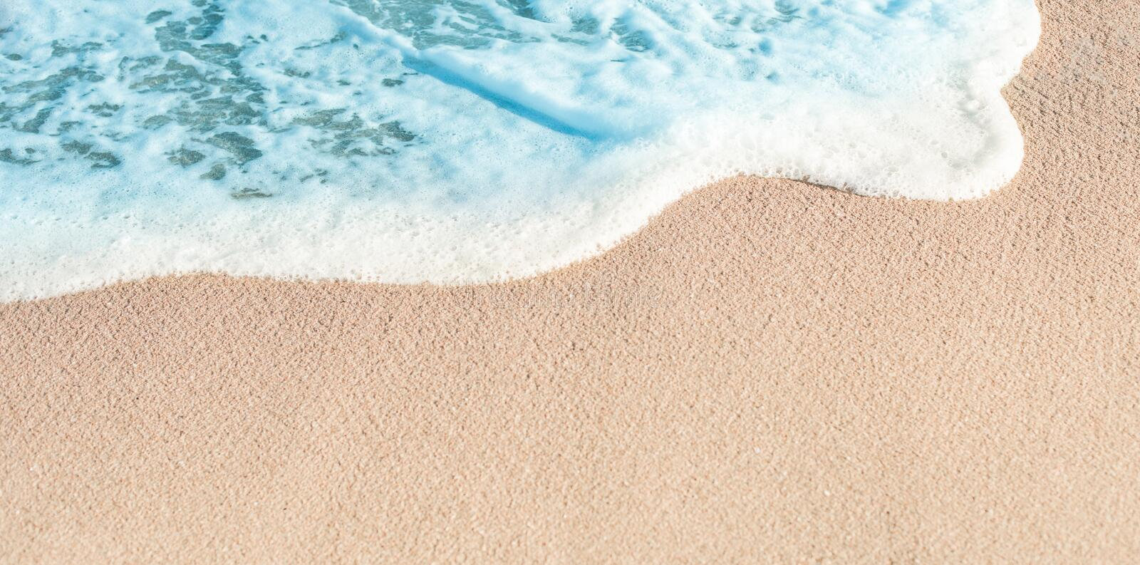 Soft Wave of Blue ocean in summer. Sandy Sea Beach Background w. Ith copy space for text royalty free stock photography