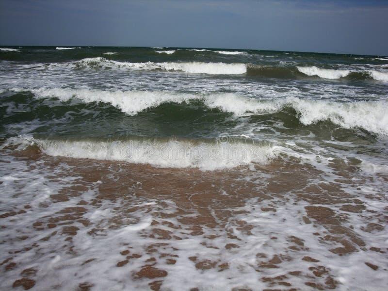 Soft wave splash on sea or ocean. Incredible foamy waves stock photos