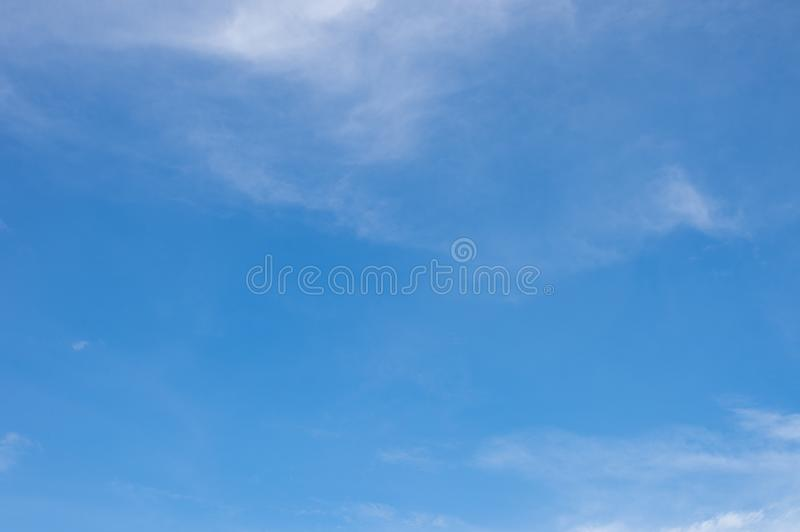 Soft white clouds and clear blue sky background with copy space for text royalty free stock image