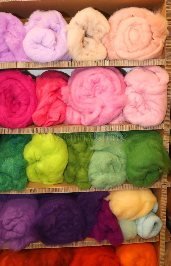 Soft wool for sale in balls in the wholesaler's shop. Fine soft wool for sale in balls in the wholesaler's shop stock photo