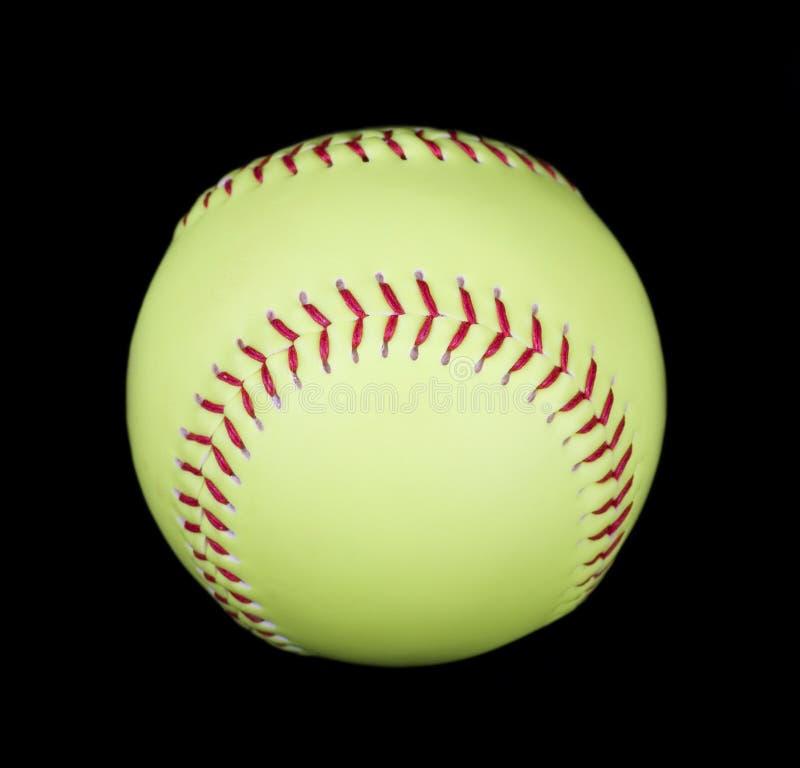 Softball giallo sul nero fotografie stock libere da diritti