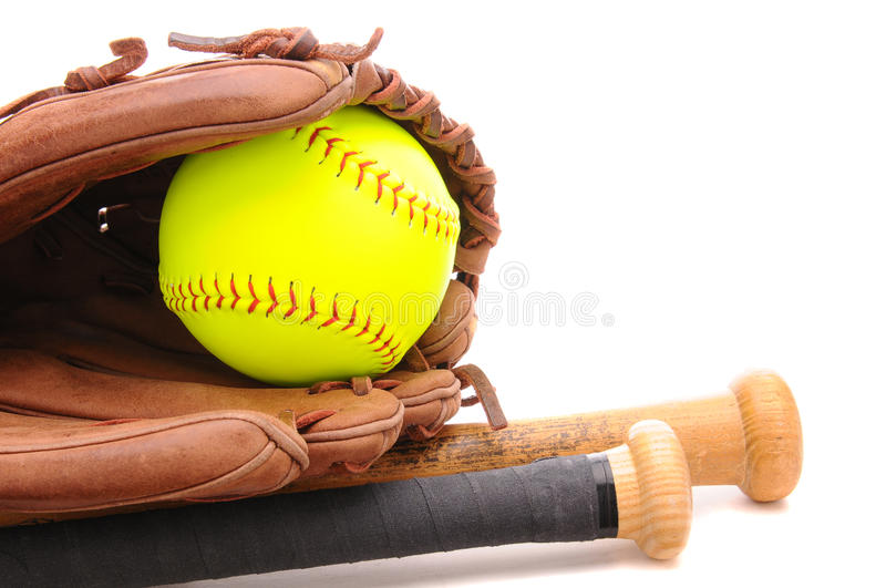 Softball Glove ball and two bats on white royalty free stock photography