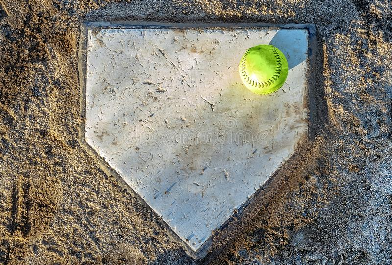 Softball on home plate stock images