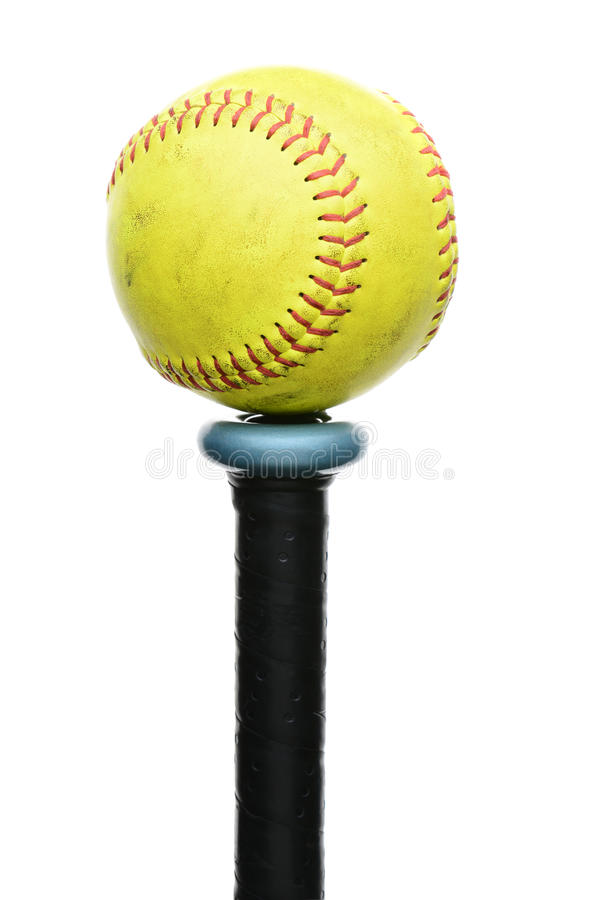 Softball on Knob of Bat. A used yellow softball resting on the knob end of an aluminum bat. Vertical format isolated on white stock photos