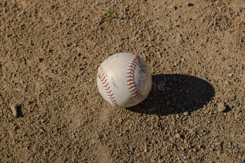 Softball. Left on Field After Being Hit stock photography