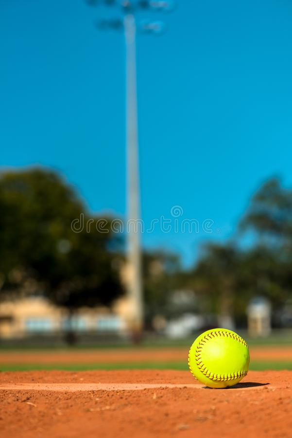 Softball on Pitchers Mound. Fluorescent Yellow Softball on Pitchers Mound royalty free stock photos