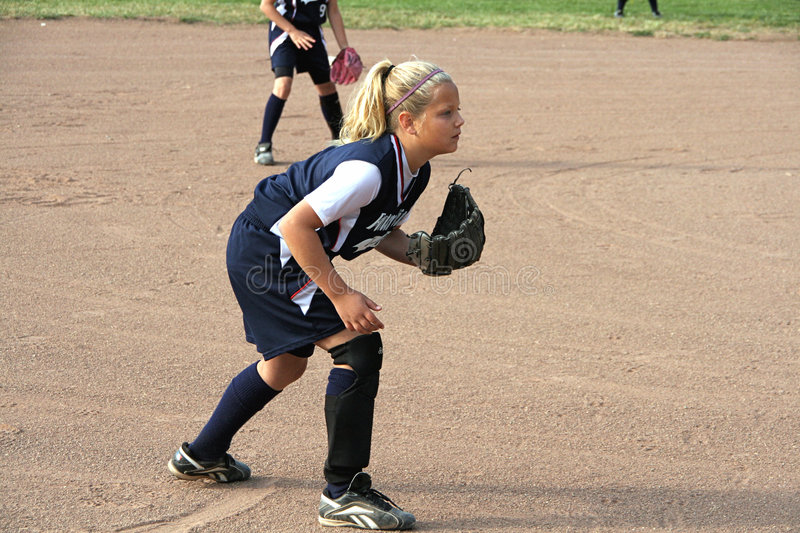 Softball player. Young girl playing Third base in a softball game stock image