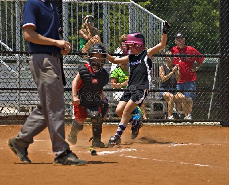 Softball Runner Making it Home stock photos