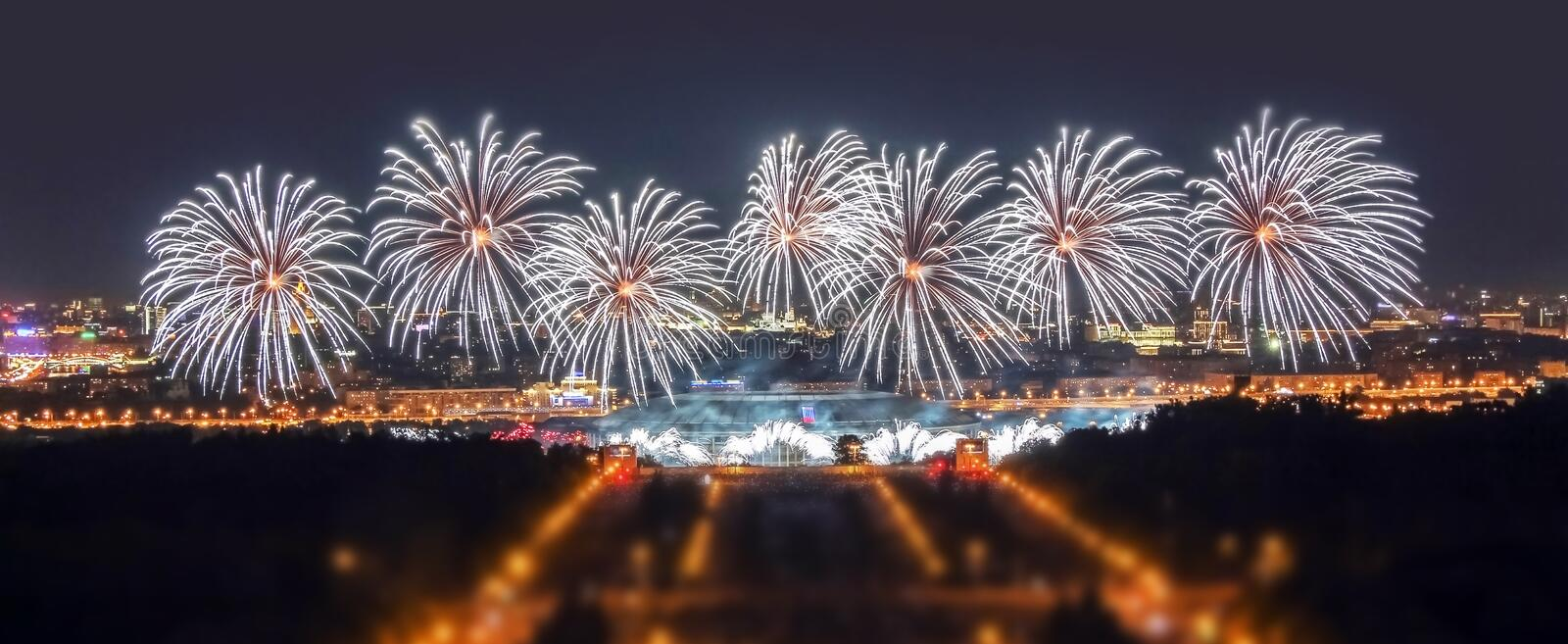 Soften edge view of Moscow firework festival in the Lenin Hills area with thousands of smart phone flashes and water reflections. Wide angle soften edge view of royalty free stock photo