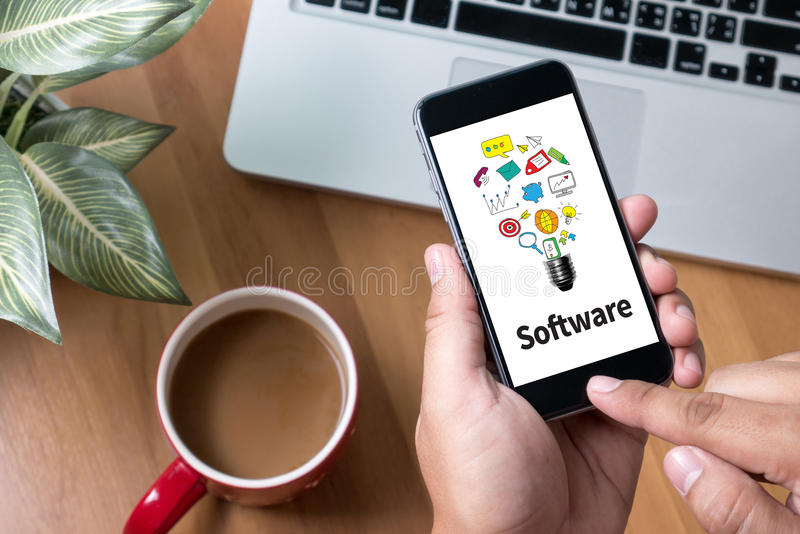 Software Data Digital Programs System Technology computer. Thoughtful male person looking to the digital phone screen,Silhouette top computer and hand royalty free stock photos
