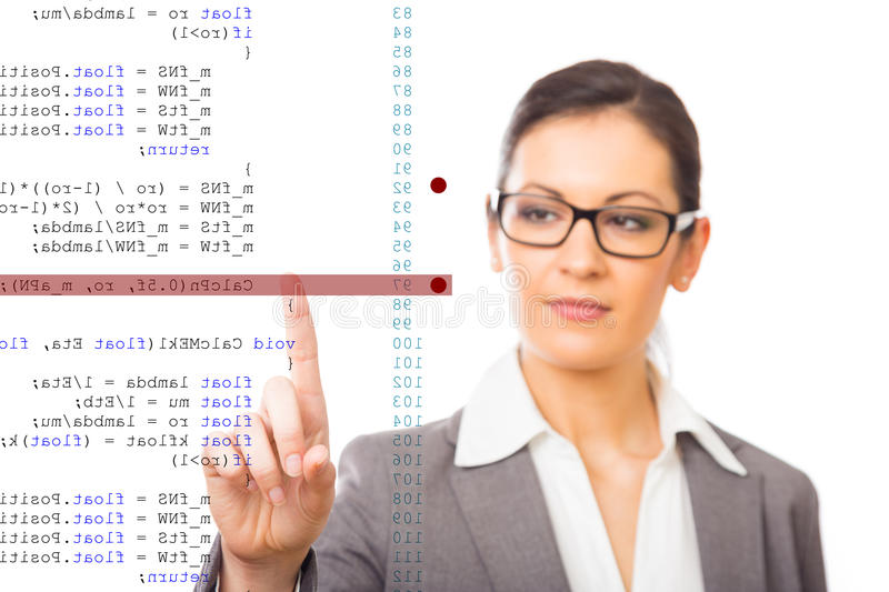 Software Debugging. A programmer is debugging his code code is mirrored horizontally stock photography