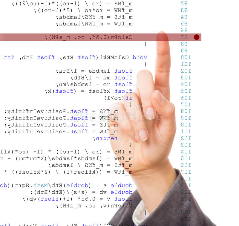 Software Debugging. A programmer is debugging his code code is mirrored horizontally stock photo