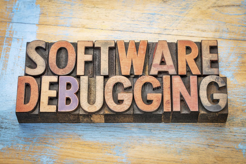 Software debugging word abstract. Software debugging - word abstract in vintage letterpress wood type against grunge wood royalty free stock photo