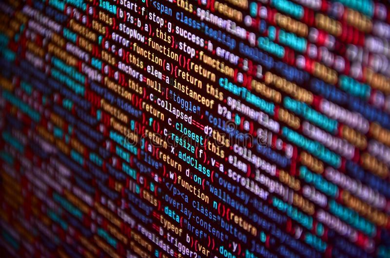 Software developer programming code on computer. Abstract computer script source code stock photos