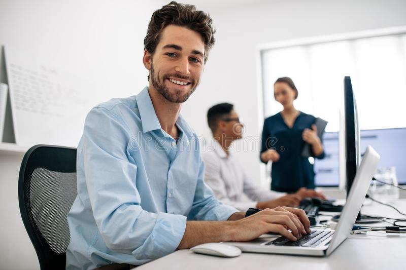 Application developers working on computers in office royalty free stock image