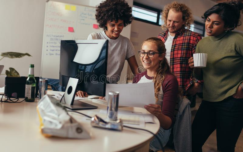 Software engineers working together on project at tech startup royalty free stock photography