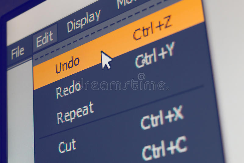 Software menu item with undo command. Highlighted and mouse cursor selected it, macro shot royalty free stock photo