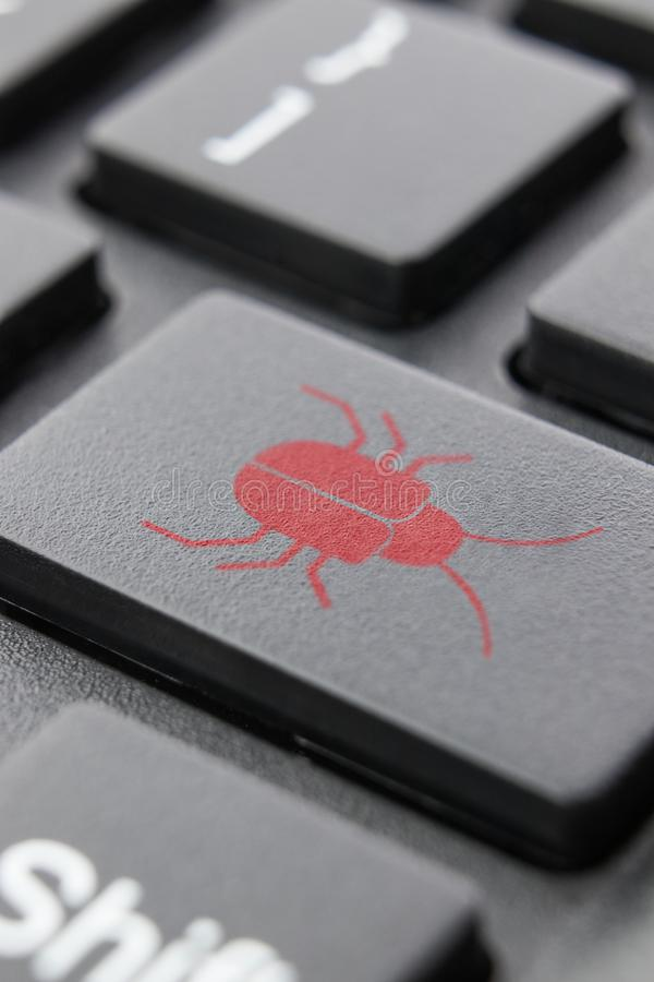 Software security concept. Errors in the program. Bugs in the program. The presence of a backdoor, rootkit. Keyboard. royalty free stock photography