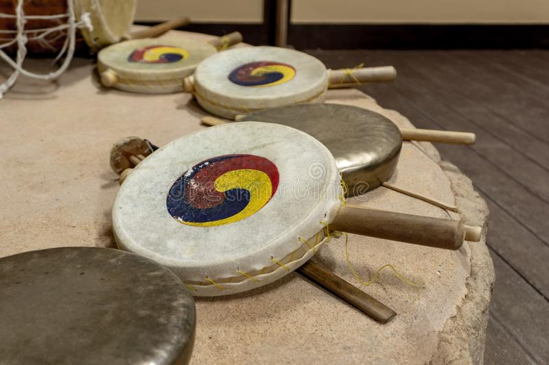 Sogo, Traditional Korean double-headed frame drum and Kkwaenggwari, a small flat brass gong. Sogo, Traditional Korean percussion, Double-headed frame drum royalty free stock photos
