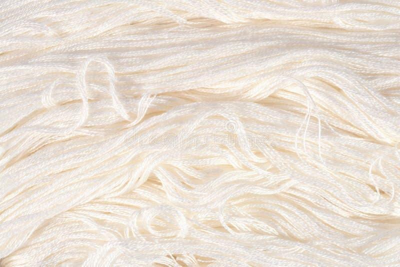 Soie blanche de broderie comme texture de fond photographie stock