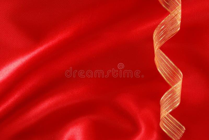 soie rouge d'or de bande photographie stock