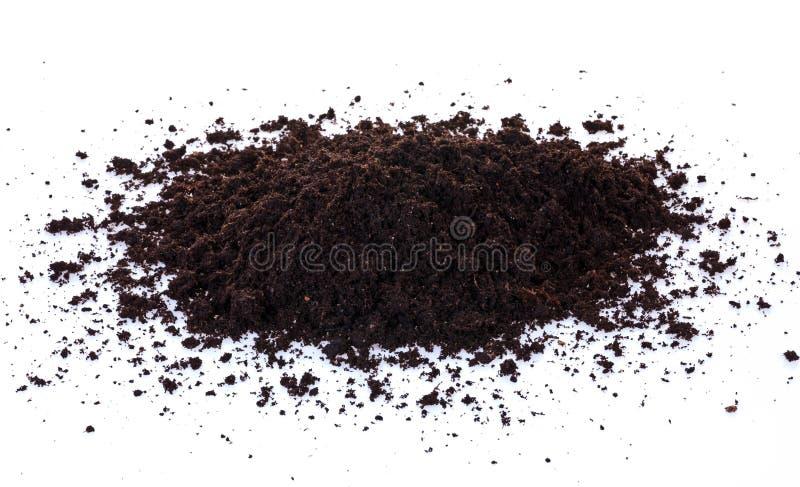 Soil. Pile of black garden top soil isolated on white background stock image