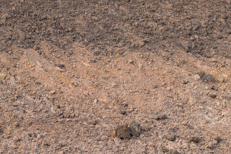 Soil background dug dry. Close to the ground floor, barren landslides are dug up to collect rainwater for agriculture stock photo