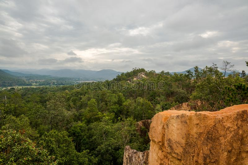 Soil Cliff Phenomenon by nature in the hill of forest mountain with cloudy sky. Countryside at the north of Thailand Mae Hong Son stock photos