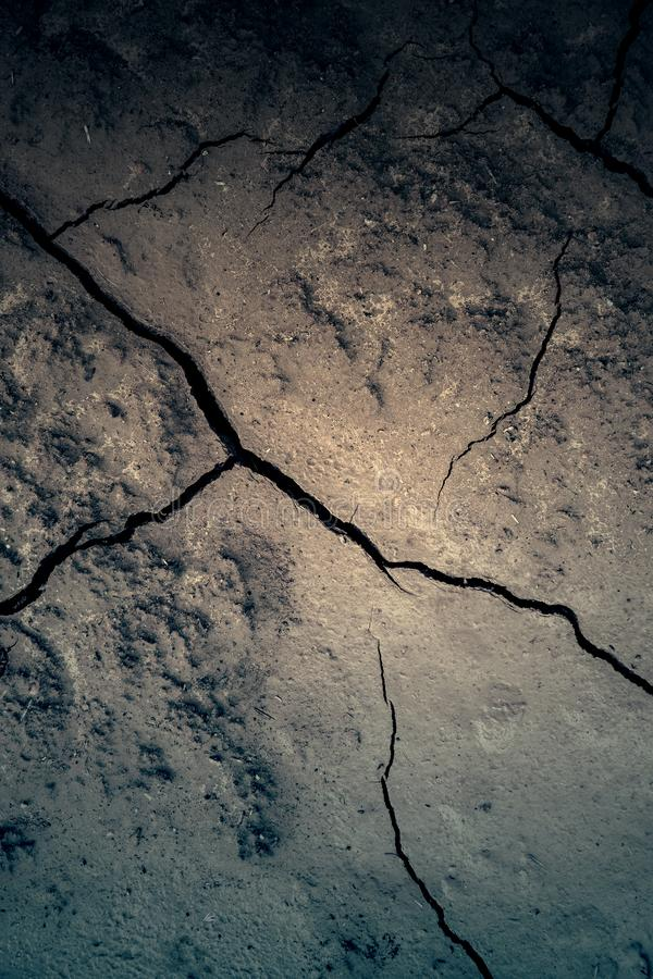 Soil cracked by a climatic disaster stock photos
