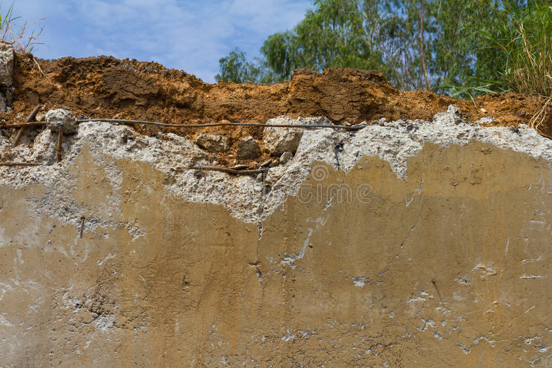 Soil cracked concrete. Break ground on concrete with demolition for the construction of a new look to the sky stock images