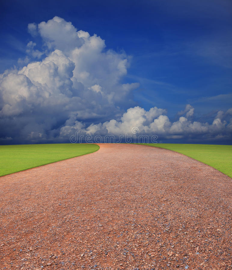 Soil road line to the horizontal with blue sky whi