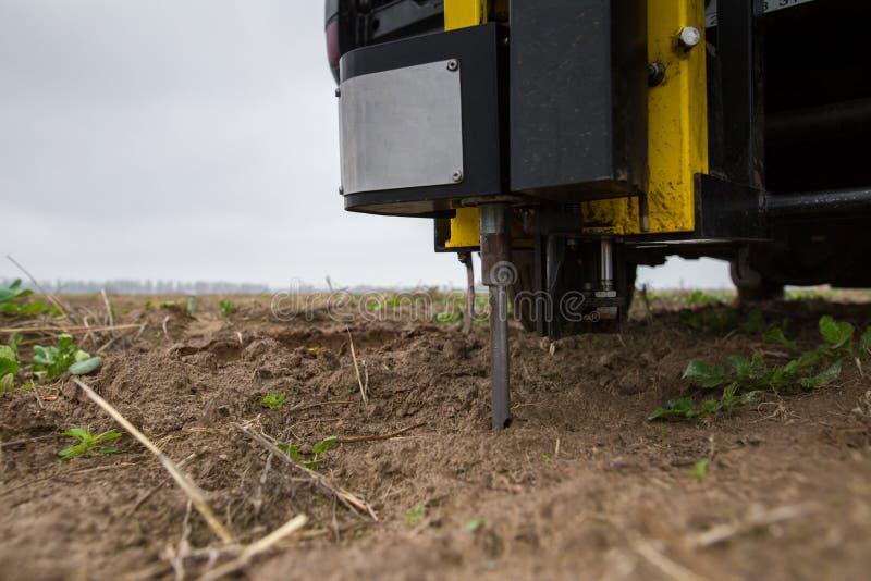 Soil Sampling. Automated probe for soil samples taking sample with soil probe sampler. Environmental protection, organic soil royalty free stock photography