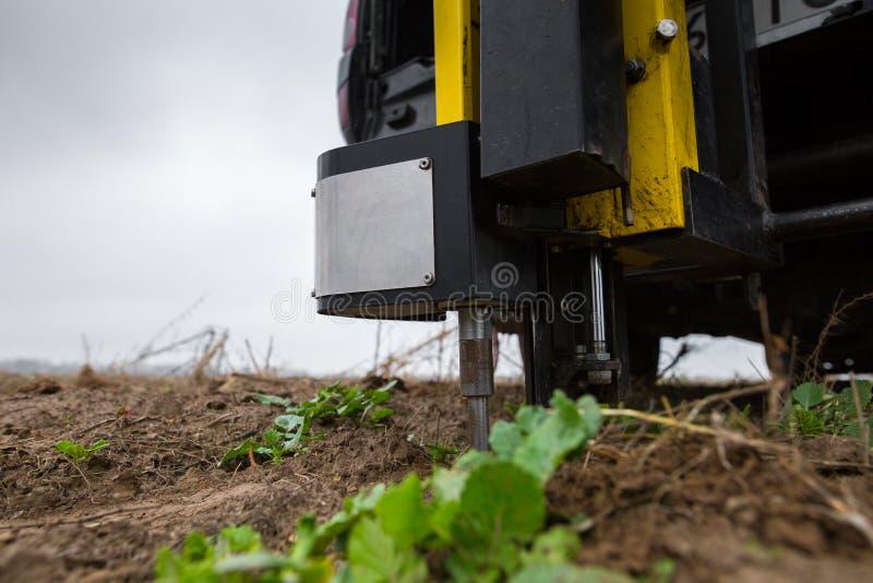 Soil Sampling. Automated probe for soil samples taking sample with soil probe sampler. Environmental protection, organic soil stock photo