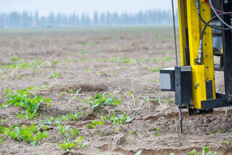Soil Sampling. Automated probe for soil samples taking sample with soil probe sampler. Environmental protection, organic soil. Certification, research royalty free stock images