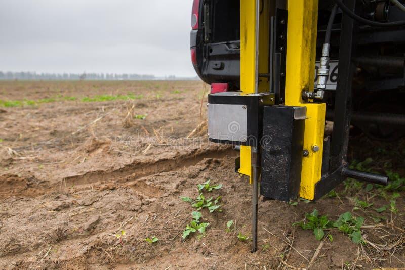 Soil Sampling. Automated probe for soil samples taking sample with soil probe sampler. Environmental protection, organic soil royalty free stock photos