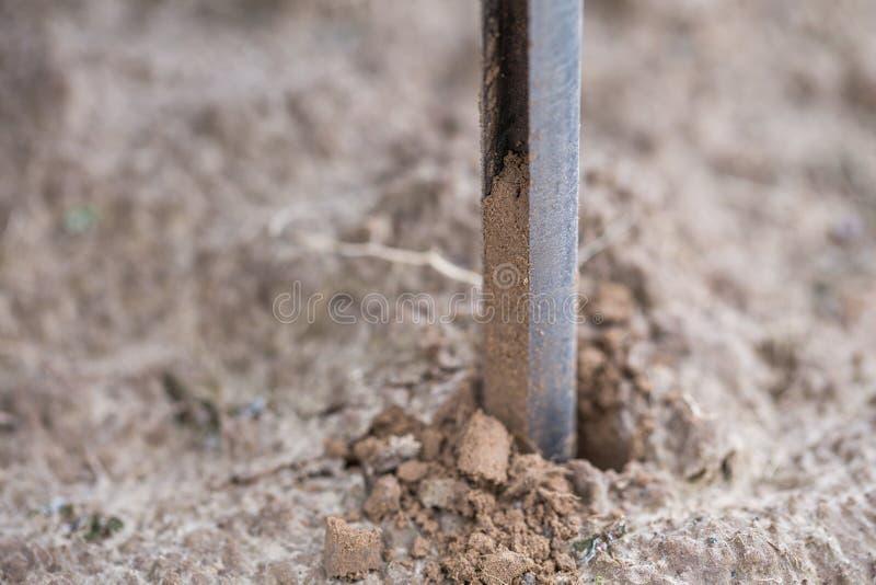 Soil Sampling. Automated probe for soil samples taking sample with soil probe sampler. Environmental protection, organic soil stock image
