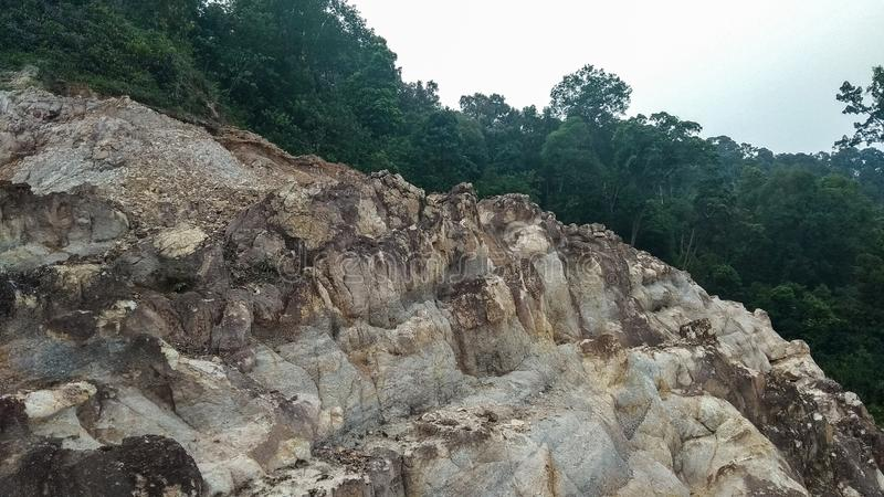 Soil texture in Batam Island. Batam, Riau Islands / Indonesia - July 03/2019.Commonly, the soil texture in Batam is brownish because it contains bauxite and lime stock photo