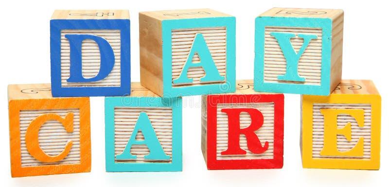 Soins de jour dans des blocs d'alphabet image stock