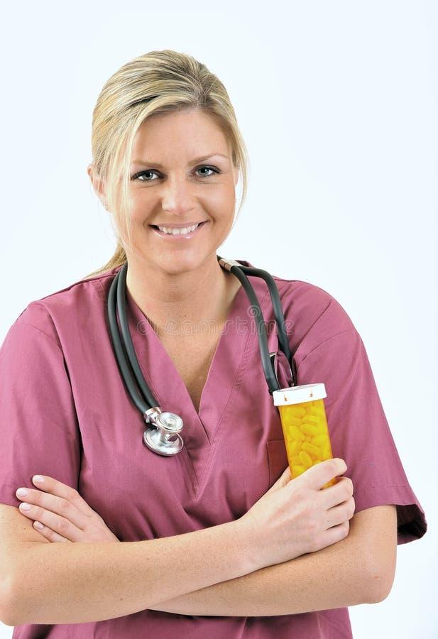 Soins de santé - pillules de fixation d'infirmière photos libres de droits