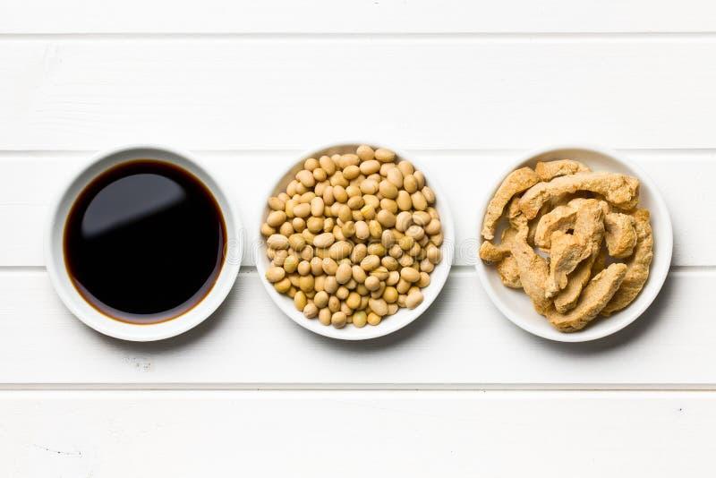 Sojasaus, sojabonen en sojavlees stock afbeelding