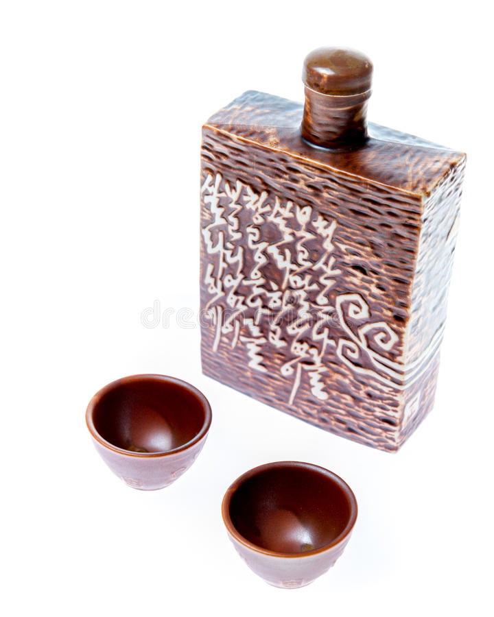 Soju decanter with two glasses stock image