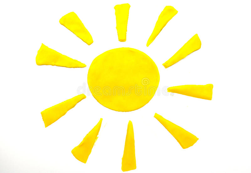 Sol amarelo pintado do plasticine no fundo fotos de stock royalty free
