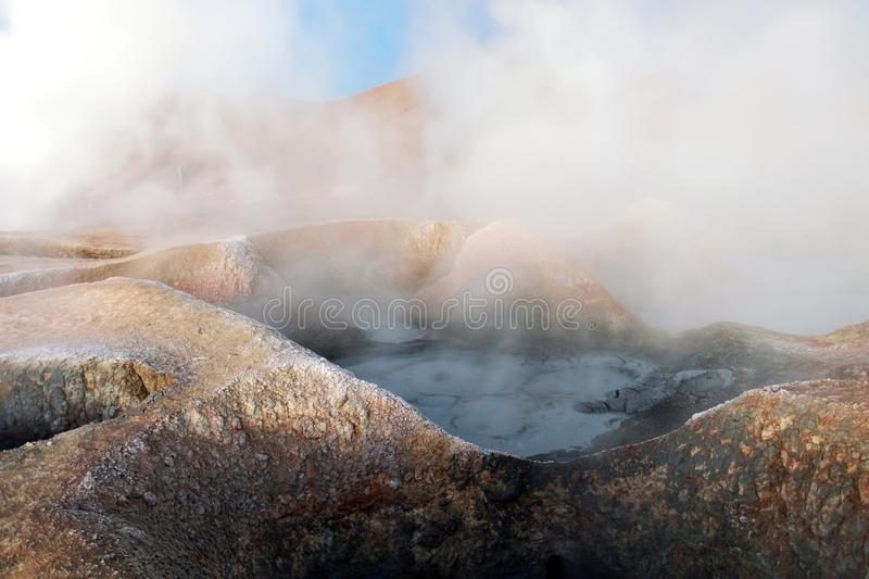 The Sol de la Manana, Rising Sun steaming geyser field high up in a massive crater in Bolivian Altiplano, Bolivia royalty free stock images